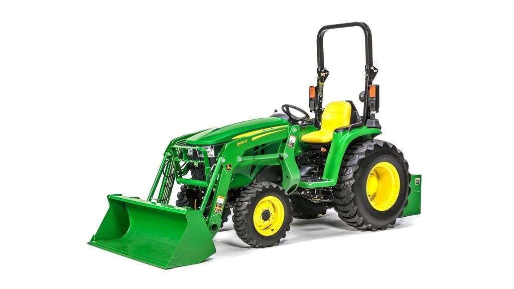 image of 300e front end loader attached to tractor in studio setting