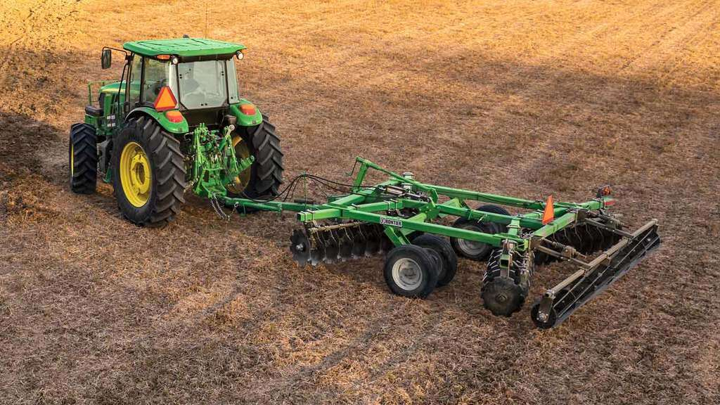 field image of Frontier DH16 series disk harrow on a tractor in a field
