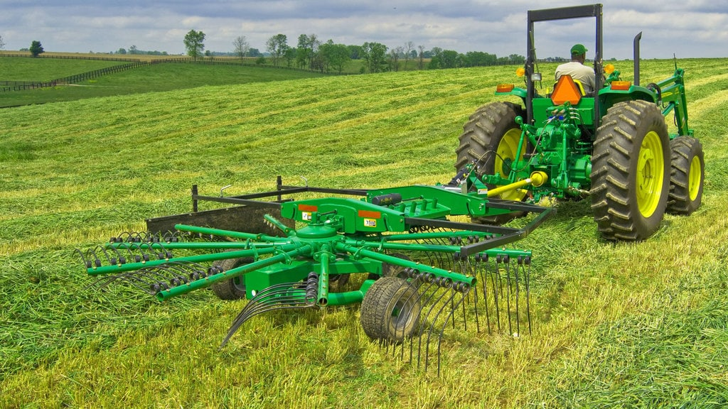 field image of Frontier rr22 rotary rake attached to a tractor