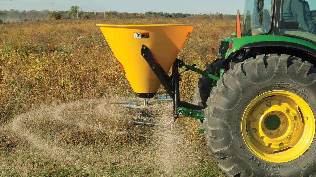 image of Frontier sb30b broadcast spreader on tractor in field