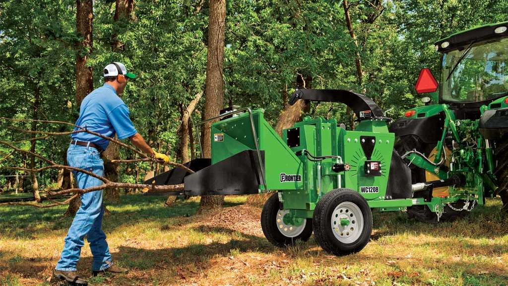 field image of Frontier WC12 series wood chipper attached to a tractor