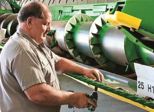 Technician Servicing John Deere Combine
